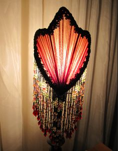 The focus is mainly on the lamp shade instead of the lamp itself, giving it a decorative design.Because decorative design focuses on the beauty of the object.