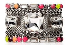 Juicy Couture chain cuff:  http://news.stylecaster.com/neon-rhinestone-jewelry-7-must-have-pieces-glam-rock