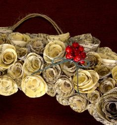 MayArtsWreath5-Chrissy's Victorian Book Print Rosette Wreath- a photo tutorial; I used ripped out pages from an old telephone book, pages from an old romance novel.The rosettes are the star of the show in this amazing holiday craft project. Here's a quick and easy step by step tutorial:
