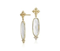 These earrings shine with elongated white topaz gemstones accented with white sapphires framed in 18k yellow gold.