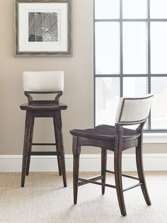 Exposed industrial elements, like the nailhead trim, distinguish the Bar and Counter Stool.   Stanley Furniture