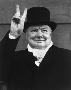 WINSTON CHURCHILL gives the victory sign at a political rally, Liverpool.  (1951)