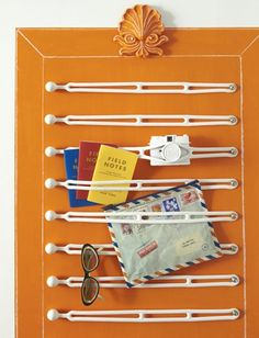 6. Rubber boating straps, stretched between two screws, turn any surface into a storage system for sunglasses, menus and what have you.