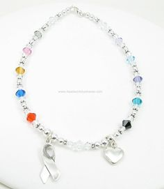 """Cancer Awareness """"Necklace"""" that Rita is hanging from her rear view mirror."""