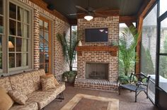screened in porch, wall mounted tv, fans, two doorways, and a fireplace? Perfect back porch for the south!