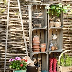 Old wooden crates for garden and patio storage.