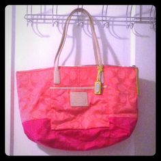 "Authentic lightweight Coach tote This lightweight Coach tote is the perfect size to hold all the essentials. It's colorblock, with coral on the top and hot pink on the bottom, with bright yellow accents. Perfect for spring/summer! Carried for one day and that's it! No flaws or marks. Comes with original care instructions and Coach dust bag. This bag has a zipper across the entire top. Feel free to make an offer through the ""make an offer"" function! Coach Bags Shoulder Bags"