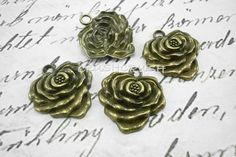 4pcs Antique Brass Metal Roses CHARMS Pendants by Crushcrush, $1.99