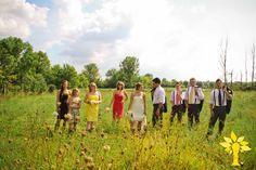 Photography:  wedding:  the bridal party in a field of wild flowers.