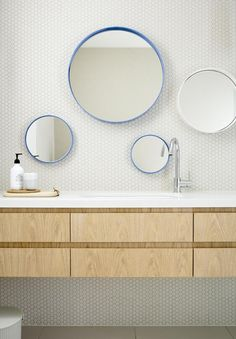 Rounded mirrors in bathroom wall