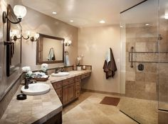 separate sinks, plenty of counter space, beautiful colors, & an enormous shower