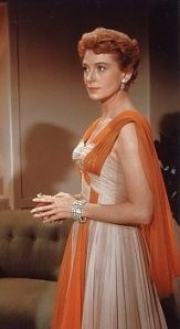 I adored this dress when I was young. I'd still wear it in a heartbeat, though w/ a blue in place of orange. Deborah Kerr, 1957, An Affair to Remember