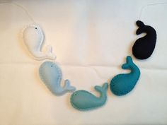 Baby whale garland in ombre blues and teals -- photo prop nursery decor. $18.00, via Etsy.