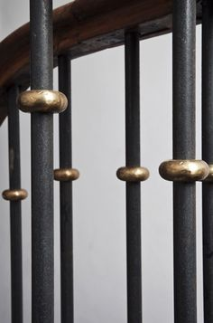 Blackened steel balusters with beaten un lacquered brass details designed by Teresa Hastings Project Notting Hill House 2010