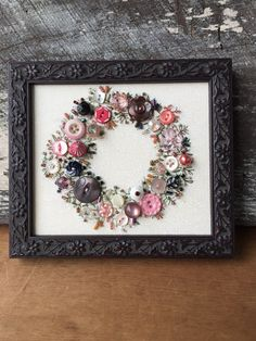Handsewn framed picture of a wreath using pink & white buttons with embroidered leaves and stems. It takes me over 100 hours to hand sew all the