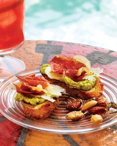 Crisped-Prosciutto and Avocado Crostini | Martha Stewart Living - Baking prosciutto turns it crisp and crunchy, making it a perfect foil for buttery avocado and a thin slice of sharp cheese.