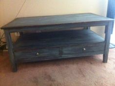 Annie Sloan chalk painted coffee table. Base coat is Graphite and the wash is Duck Egg blue.