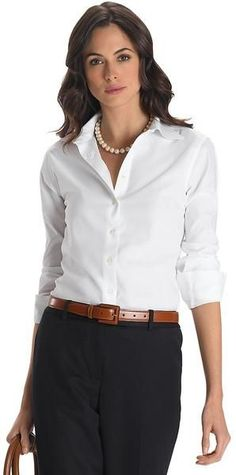 Wear a no-iron white blouse on the plane, and pack a silk shell and black pencil skirt to wear the next day with your blazer or a cardigan.