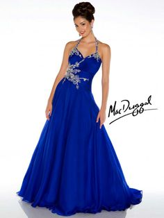 Rhinestone halter neckline with rouched fitted bodice opens into a full chiffon skirt with floral bead work adoring the side and halter top. This prom dress is the epitome of style and grace.