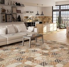 Moments Floor And Wall Tiles from Tile Mountain used to zone the living area and the kitchen