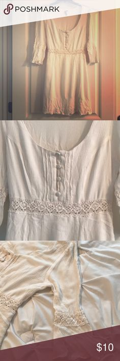 White summer dress with lace waste-line. Cute white dress with stretchable fabric and a lace waste-line. It has a slip attached underneath so it is not see through other than the waste-line. Dresses Mini