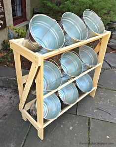 Free plans to build open shelves to hold buckets for storage. Flower Shop Decor, Flower Shop Design, Flower Truck, Flower Cart, Flower Shop Interiors, Bucket Gardening, Farm Store, Flower Stands, Open Shelves