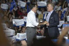 40 10/1/12  4 of 38  Mitt Romney is introduced by Denver Broncos Hall of Fame quarterback John Elway during a presidential campaign rally at Wings of the Rockies Air and Space Museum on Monday, October 1, 2012. AAron Ontiveroz/The Denver Post