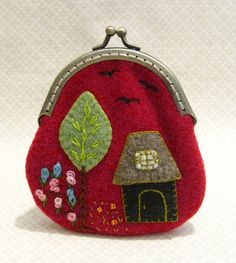 coin purse  This has a little red riding hood feel to it.