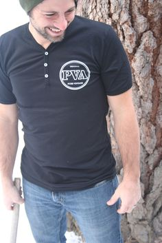 Black, 100% cotton, button up V neck T, with white PVA logo on left breast. Printed on American Apparel. Made in the USA