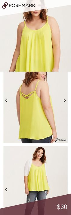 """Pleated Front Georgette Cami Top This cami toplookssimple, but there's tons of surprising details. It's swathed in an eye-popping neon lime green semi-sheer georgette that swings, with a lightweight, and flowy fit thanks to a pleated front. The itty-bitty adjustable straps lead to a skin-baring crossback.  * measures 29 1/2"""" from shoulder * Polyester * Wash cold, dry low Torrid Tops Camisoles"""