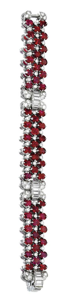 RUBY AND DIAMOND BRACELET, VAN CLEEF & ARPELS, 1952.  The articulated band composed of three lines of oval rubies spaced by collet-set brilliant-cut diamonds, highlighted with brilliant-cut and baguette diamond links, mounted in platinum,