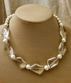 Check out this item in my Etsy shop https://www.etsy.com/ca/listing/260492558/glass-pearl-and-glass-bead-choker-pearl