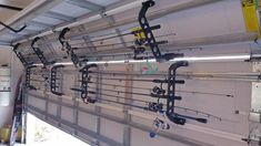 Make your doors moonlight as fishing buddies with these garage door racks that can hold fishing rods, lawn tools, and other long, skinny items you need on hand, but out of the way. 26 Ridiculously Clever Storage Ideas For Your Garage Garage Tools, Garage Shop, Diy Garage, Garage Workshop, Garage Bathroom, Bathroom Ideas, Boat Garage, Small Garage, Garage House