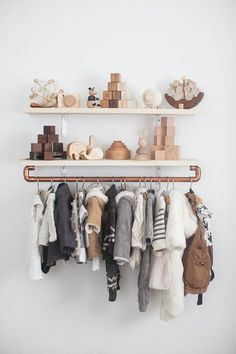 Copper pipes are all the rage in home decor. This is a great way to add storage to a nursery! Paired with wooden accents, you've got yourself a trendy little clothing rack.