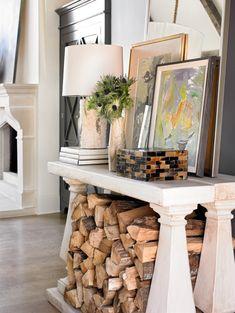 Firewood stacked under  - Melanie Turner