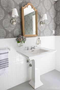 LOVE this bathroom makeover with stenciled walls that look like wallpaper, wood medicine cabinet, twin sconces, and painted tile floors! Bathroom Makeovers On A Budget, Budget Bathroom, Small Bathroom, Bathroom Ideas, Bathroom Pink, Bathroom Wall, Bathroom Towels, Bathroom Renovations, Relaxing Bathroom