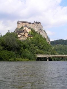 Photographer's Note  Above the river rises Orava Orava Castle, which is the first recorded mention of the year 1267 The highest part of the castle is located 112 meters above the river Orava. Its present appearance of the castle in the early 17th century.