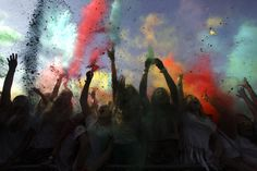 Revelers throw colored powders in the air during the Holi Festival of Colors in Lisbon, Sunday, Sept. 15, 2013. The festival, which is mainly celebrated during the Hindu spring festival Holi in some regions of India and Nepal, has become popular among people in other communities. (AP Photo/Francisco Seco, File)
