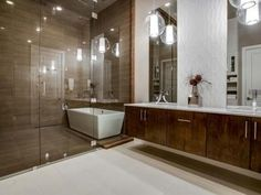 Bella Vita Custom Homes master spa retreats deliver a luxurious experience enhanced by natural elements and textured accents to provide the ultimate oasis. www.livingbellavita.com