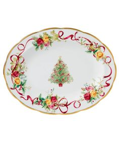 Royal Albert offers a festive twist on a favorite pattern, mixing Christmas trees, holly and bows with pink and gold blooms on the Old Country Roses Holiday platter. Gold-banded porcelain coordinates