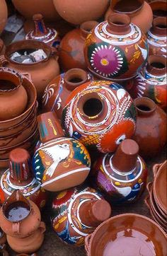 Mexico. Purepecha pottery. pile of ceramic pots at the market in Tarecuato Michoacan.