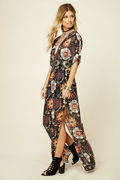 A woven floral print maxi dress with a smocked waist, a plunging V-neckline and self-tie V-cut back, short sleeves, and high-slit sides.