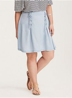 "Flirting comes easy with a skirt like this. The mini length definitely catches your crush's eye, while the light wash denim - that's more like a chambray - guarantees that whole ""can I have your number"" conversation. The lace up ties are a naughty embellishment that guarantee a second date.Size 14 measures 21"" from center front"
