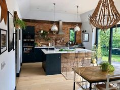 dark kitchen with exposed brick wall of Sharon hornsby_style Living Room Kitchen, Home Decor Kitchen, Home Kitchens, Dark Kitchens, Kitchen Ideas, Industrial Kitchen Design, Interior Design Kitchen, Rustic Industrial Kitchens, Modern Industrial