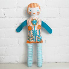 Martha Stewart has a free template for dolls like this.  Note to self: have fun with color!