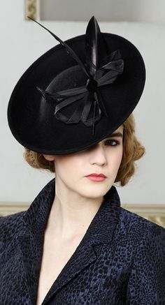 Jane Taylor Millinery, Lilia, A/W 2013 - Wool felt disc with feathers, bow & Swarovski crystal detail. #passion4hats