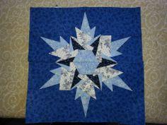 Paper Pieced Snowflake block.  84 scraps of fabric.