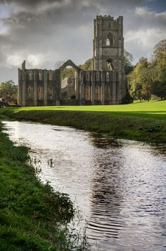 Fountains Abbey, North Yorkshire, England - The beautiful waters and the scenery demonstrated why the Abbey was built there.   It was a beautiful moment shared with my young family..........