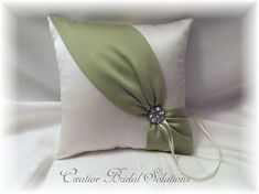 Ring pillow done in Ivory satin with a diagonal sash in Sage Celedon, adorned with a silver rhinestone button. Pillow is a 8 square and has a strap on the back for holding Sale is final Other matching pieces also available, by request Pillow Crafts, Diy Pillows, Decorative Throw Pillows, Cushions, Wedding Pillows, Ring Pillow Wedding, Wedding Ring, Hand Embroidery Videos, Ribbon Embroidery