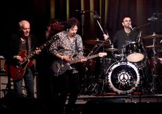 Peter Frampton (L-R) Musicians Peter Frampton, Steve Lukather and Ringo Starr perform at the David Lynch Foundation's benefit honoring Ringo...